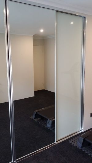 Framed-sliding-wardrobe-door-perth-painted-white-glass-and-mirror-160